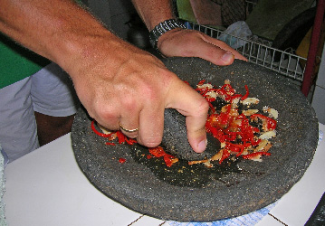 Preparing Balinese sambal during a cooking class in Warung Bambu